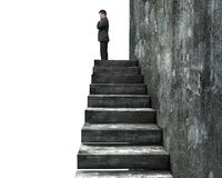 Side view of man standing on top of concrete stairs Royalty Free Stock Images