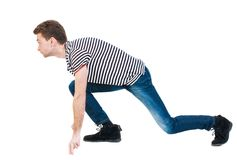 Side view man start position. Rear view people collection.  backside view of person.  Isolated over white background. The guy in the striped shirt is getting Royalty Free Stock Photos