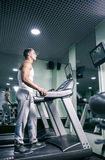 Side view of man on track in gym Stock Photography