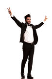 Side view of a man in tuxedo with hands up Stock Photography