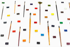 Side view of many paint brushes and watercolors Royalty Free Stock Photo