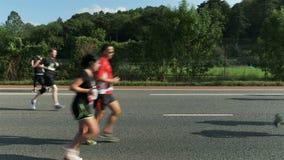 Side view marathon runners. Marathon runners, side view in bristol stock video