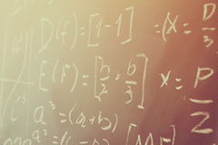 Side view of math formulas and calculation written over chalkboard. selective focus. Royalty Free Stock Photography