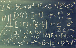 Side view of math formulas and calculation written over chalkboard. selective focus. Stock Photos