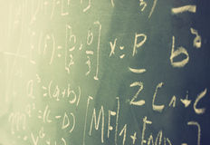 Side view of math formulas and calculation written over chalkboard. selective focus. Stock Photo