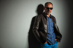 Side view of a mature casual man in leather jacket Stock Images