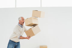 Side view of a mature man carrying boxes stock photography