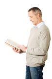 Side view mature man reading a book Stock Image