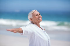 Side view of mature woman posing with outstretched arms Royalty Free Stock Photography