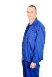 Side view mature worker in uniform Royalty Free Stock Photography