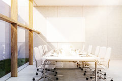 Side view of meeting room with grass, toned Royalty Free Stock Image