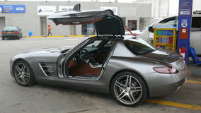 Side view of a Mercedes Benz SLS AMG 6.3. Lima, Peru. May 14, 2011. Side view of a silver color with beige leather gullwing Mercedes Benz SLS AMG 6.3 in mint Stock Photo