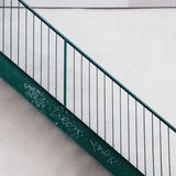 Side view of a metallic green stairs Stock Photos