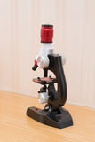 Side view microscope for kid to research nature. Side view microscope for kid to research the nature royalty free stock photo