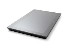 Microsoft Surface Pro tablet. Side view of a Microsoft Surface Pro tablet computer laid flat, isolated on white Stock Image