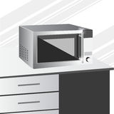 Side view of microwave in a kitchen Royalty Free Stock Photos