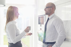 Side view of mid adult business couple talking at home Stock Photography