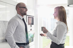 Side view of mid adult business couple talking at home Royalty Free Stock Photo