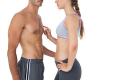 Side view mid section of a fit young couple Royalty Free Stock Photography
