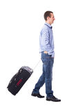 Side view of middle aged business man walking with suitcase isol Royalty Free Stock Images