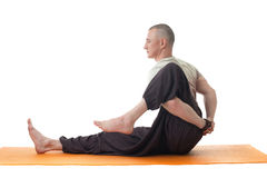 Side view of middle aged man doing yoga in studio Stock Images