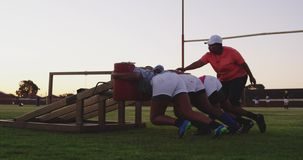 Young adult female rugby players training stock video