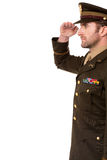 Side view of military officer salutation. Young military general saluting, studio portrait Stock Image