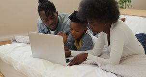 Family using laptop together at home