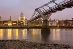 Side view of Millennium Bridge with Saint Paul Cathedral on background. London, United Kingdom- March 10, 2017: Side view of Millennium Bridge with Saint Paul Royalty Free Stock Images
