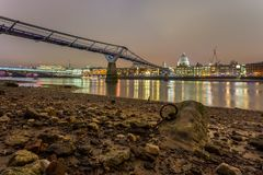 Side view of Millennium Bridge with Saint Paul Cathedral on background. London, United Kingdom- March 10, 2017: Side view of Millennium Bridge with Saint Paul Stock Image