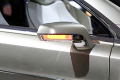 Side view mirror. Of a luxury sports car Stock Images
