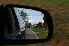 Side view mirror. On minivan Royalty Free Stock Photo