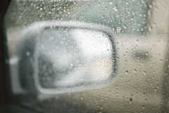 Side view mirror. A car's side view mirror in the rain Royalty Free Stock Photography