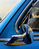 Side View Mirror of Chevrolet Fleetmaster. Detail view of side view mirror of a Chevrolet Fleetmaster automobile Royalty Free Stock Photos
