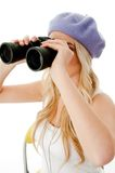 Side view of model looking through binocular Stock Images