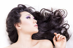 Side view of model portrait with black hair over white Royalty Free Stock Image