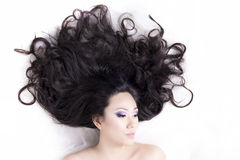 Side view of model portrait with black hair over white Stock Photography