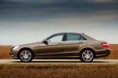 Side view of modern business sedan Royalty Free Stock Images