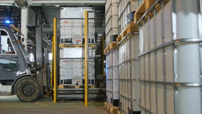 Side view modern powerful forklift takes and transports tanks stock footage
