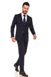 Side view of a modern smiling business man walking Stock Photos