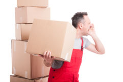 Side view of mover guy holding box and screaming Stock Image