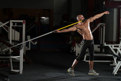 Side view Of Muscular Bodybuilder Throwing Javelin Royalty Free Stock Images