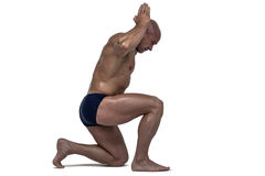 Side view of muscular man exercising Stock Photography