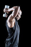 Side view of muscular man exercising with dumbbell Royalty Free Stock Photos