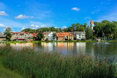 Side view with my hometown Talsi. Houses reflecting in the lake. stock photos