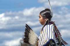 Side view of Native American against blue sky. Coeur d'Alene, Idaho USA - 07-23-2016. Young dancers participate in the Julyamsh Powwow on July 23, 2016 at the Stock Photography