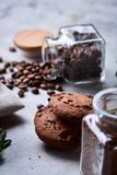 Roasted coffee beans get out of overturned glass jar on homespun tablecloth, selective focus, side view. Side view of natural roasted coffee beans get out of Royalty Free Stock Photos