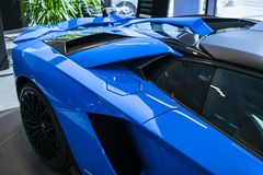 Side view of a new Lamborghini Aventador S coupe. Headlight. Car detailing. Car exterior details royalty free stock image