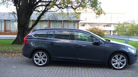 Side view of new Volvo electric car parked in front. Karlsruhe, Germany - Oct 29, 2017: Panning scene new Volvo electric car parked in front of Federal stock footage