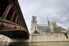Side View of Notre Dame and Seine River Royalty Free Stock Images